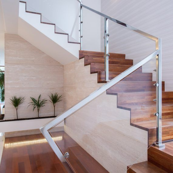 stunning oak staircase with bright glass railings